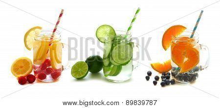 Detox water with fruit in mason jars isolated on white