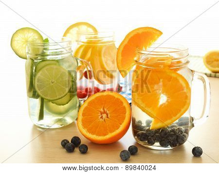 Detox water with various types of fruit in mason jars