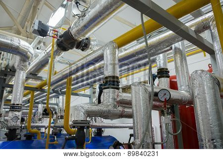 Place in a large industrial boiler room.