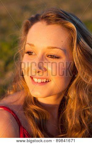 Pretty cool woman smiling with a beautiful light on her face
