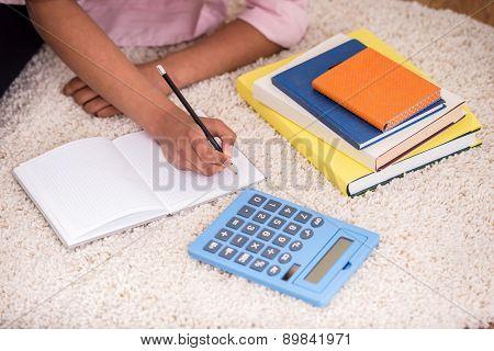 Mulatto Girl Doing Homework