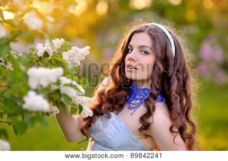 Beautiful Girl On A Background Of White Flowering Trees