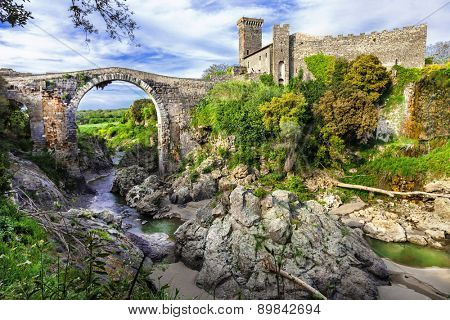 impressive ancient bridge and castle Vulci - Lazio, Italy
