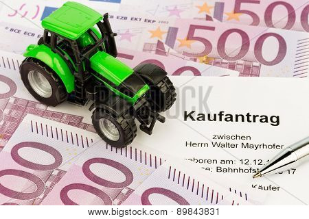 the purchase contract for a new tractor. with euro money and pen
