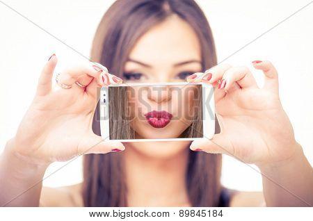 Girl taking selfie of her kissable lips