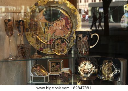 VIENNA, AUSTRIA - AUGUST 20, 2012: Dishes and glasses decorated with motive of the Kiss by Austrian painter Gustav Klimt seen in a souvenir shop window in Vienna, Austria.