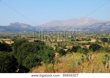 Greek landscape with meadow, mountain and blue sky, Creta island.