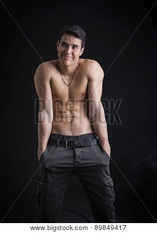 Shirtless young man outdoor doing silly face and stupid pose