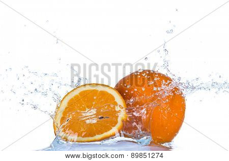 Fresh orange in water splash isolated on white background