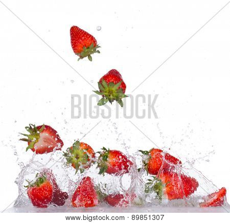 Fresh strawberries in water splash isolated on white backround