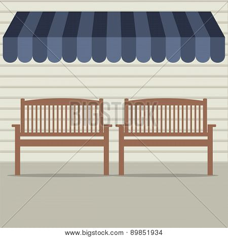 Empty Wooden Chairs Under Awning.