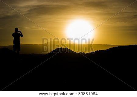 Silhouette capturing the sunset - Atacama Desert
