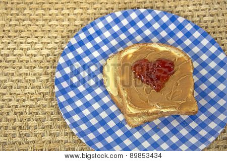 Jelly heart on peanut butter