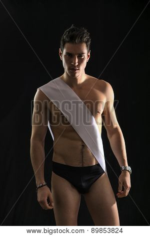 Handsome shirtless guy wearing winning ribbon or sash