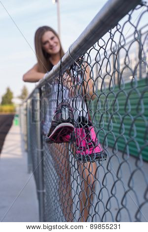 Female Track And Field Athlete With Shoe Shot.