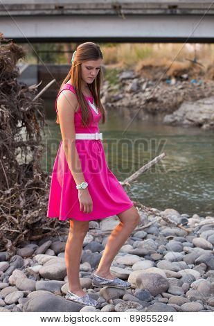 Young Audlt Portrait In Pink Dress Outdoors.
