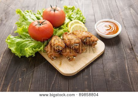 Fried Chicken Wings On Wooden Background