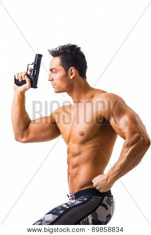 Athletic Topless Man Holding Handgun Against White