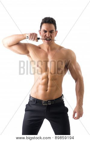 Muscular man holding big knife biting blade