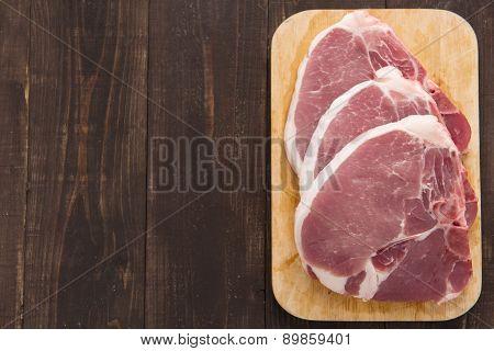 Raw Pork Chop Steak On Wooden Background