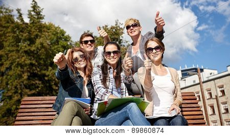 summer holidays, education, campus and teenage concept - group of students or teenagers showing thumbs up