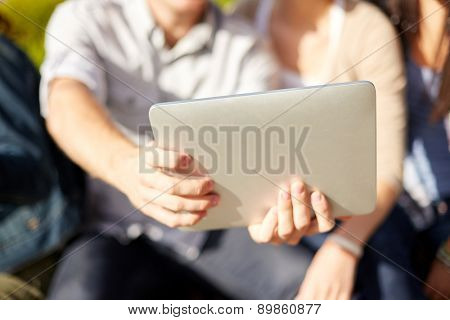 summer, technology and people concept - close up of friends with tablet pc taking selfie