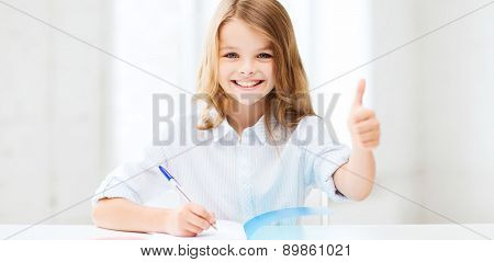 education and school concept - smiling student girl studying at school