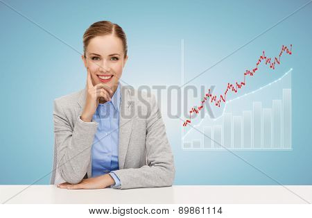 business, education, people and office concept - smiling businesswoman sitting at table with growing chart over blue background