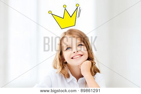 education, childhood, people and school concept - smiling little school girl daydreaming at school with crown doodle