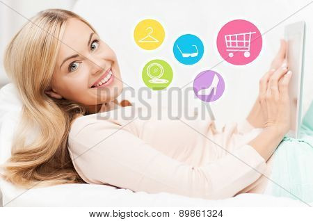 online shopping, sale, fashion and people concept - happy woman or housewife with laptop shopping online at home