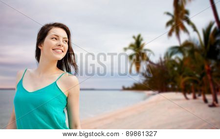 summer holidays, people, youth and happiness concept - happy girl or young woman looking aside