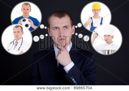 Business Man Thinking Or Dreaming About His Future Over Dark Background