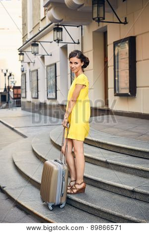 Beautiful Woman With The Suitcase At The Entrance To The Hotel