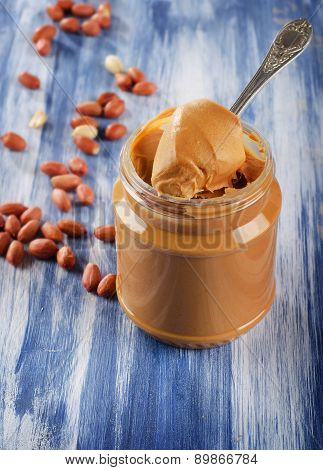 Peanut Butter In  Jar With Peanuts.