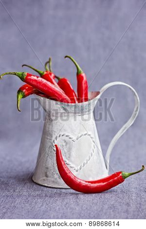 Hot Red Chili Peppers In A Metal Gray Basket On Bluish Background , Vertical Composition
