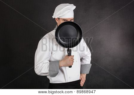 Chef Behind Pan