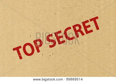 Top secret stamping on brown paper