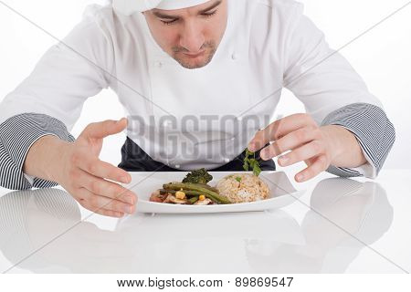 Chef Decorating Prepared Food On Plate