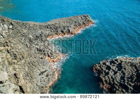 Basaltic columnar joint coast Natural rock in JeJu Island Korea.