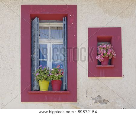vintage home windows with flowerpots