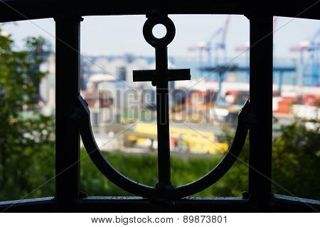 Silhouette Of An Anchor In The Fence And Sea Port