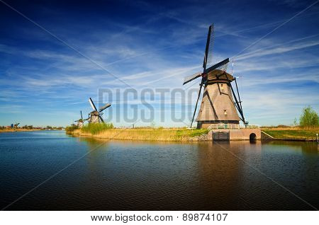 Windmills At Riverside On A Sunny Day, Netherlands