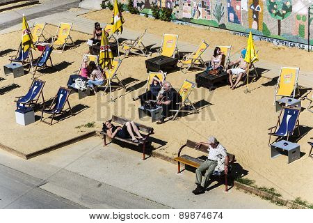 People Relax At The Beach Of The Danube Canal In Vienna