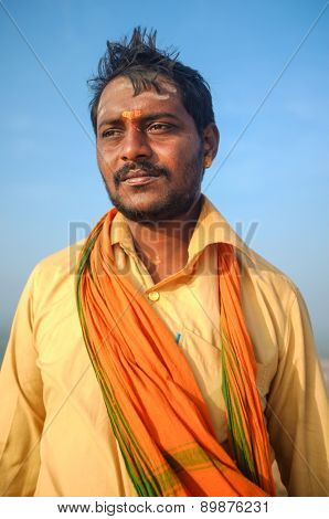 KAMALAPURAM, INDIA - 03 FEBRUARY: Indian pilgrim with scarf in a lungi and painted forehead on hilltop