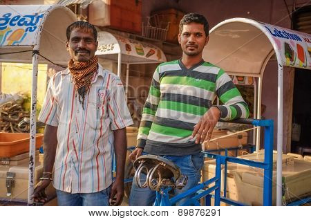 KAMALAPURAM, INDIA - 02 FEBRUARY 2015: Indian ice-cream vendors on a market close to Hampi
