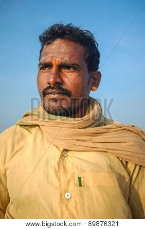 KAMALAPURAM, INDIA - 03 FEBRUARY: Indian pilgrim with scarf and painted forehead on hilltop