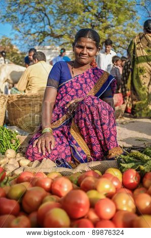 KAMALAPURAM, INDIA - 02 FEBRUARY 2015: Indian lady selling vegetables on a market close to Hampi