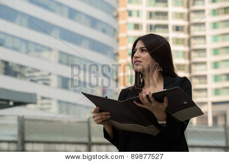 Businesswoman Holding Document For Check Her Job
