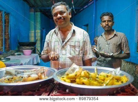 KAMALAPURAM, INDIA - 02 FEBRUARY 2015: Two Indian family members inside their restaurant waiting for customers