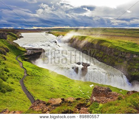 Water abyss. Enormous waterfall Gyullfoss. Summer in Iceland